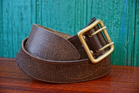 old brown army belt made of leather