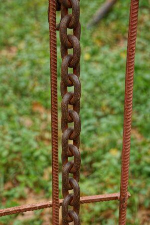 long iron rusty chain on steel bars chain