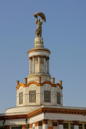the top of a historic building with the figure of a woman against the sky Stock Photo