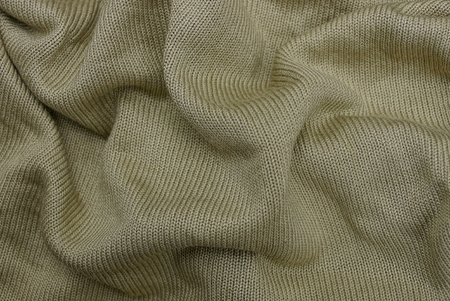 green texture of crumpled cloth from clothing