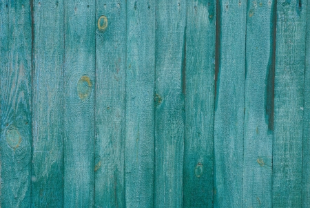 green background of the wall fence boards on the street