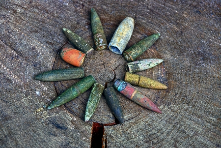 old bullets on gray wood