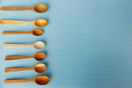 small wooden spoons on a blue table