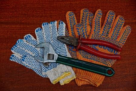 Construction gloves and old tools on the table