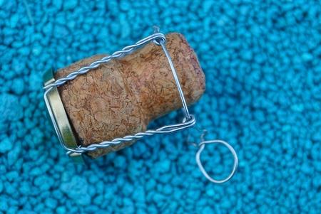 large brown cork on blue fine sand