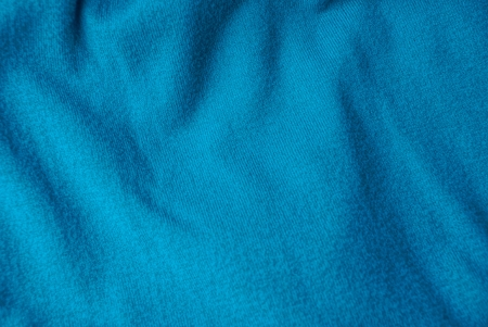 turquoise woolen texture from a fragment of crumpled clothes