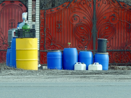 Set of barrels and boots beside the road