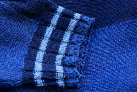 blue fabric texture of woolen sweater with a sleeve