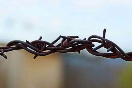 a piece of rusty barbed wire on the street