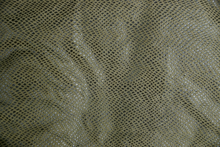 green black spotted skin texture on clothes