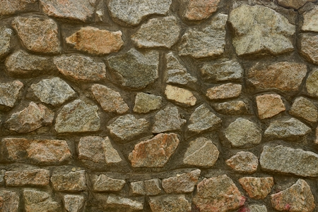 gray brown stone texture of large cobblestones in the wall
