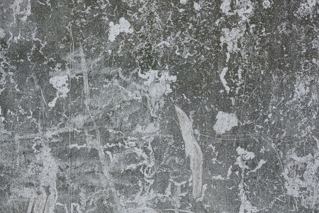 Gray stone texture from a worn concrete wall