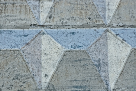 Gray stone texture of a concrete wall painted with silver paint