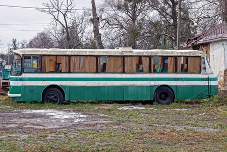big old bus is standing on the street in the grass Reklamní fotografie
