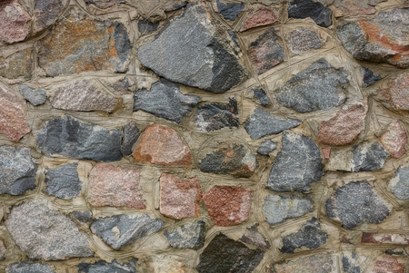 stone texture of large cobblestones in the foundation of the wall Banco de Imagens