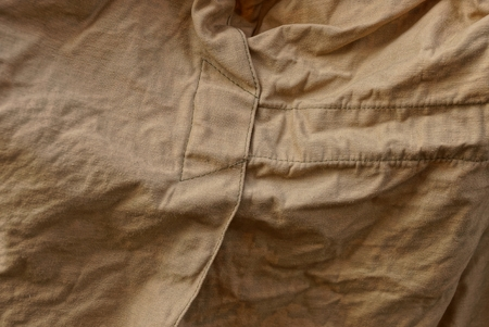 brown fabric texture from a piece of crumpled old clothes Imagens
