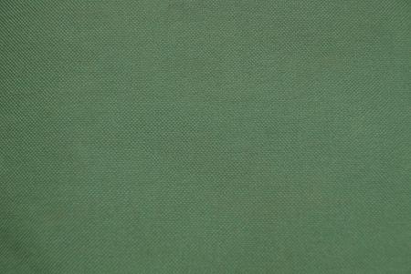 布の一部から緑の生地のテクスチャ