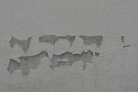 gray texture of rubbed plaster on a worn wall
