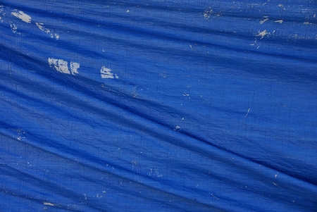worn tarp covering Stock Photo