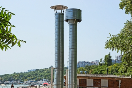 two gray metal chimney pipes Standard-Bild - 116487175