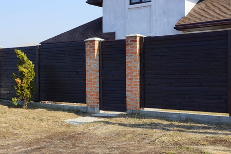 brown gate and wooden fence
