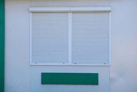 roller shutters on a gray wall
