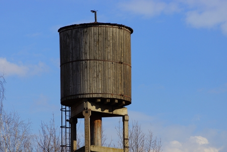 old gray wooden water tower