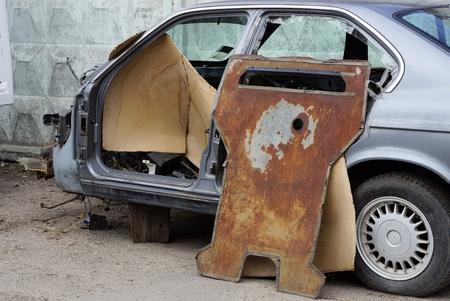 car parts on the street near the fence