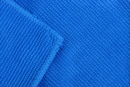 blaue Stoffstruktur aus einem Stück Mikrofasertuch