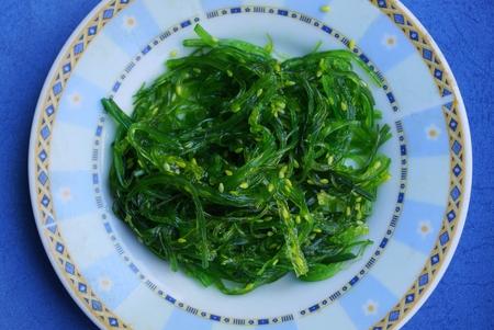 fresh green hiyashi salad on a blue table