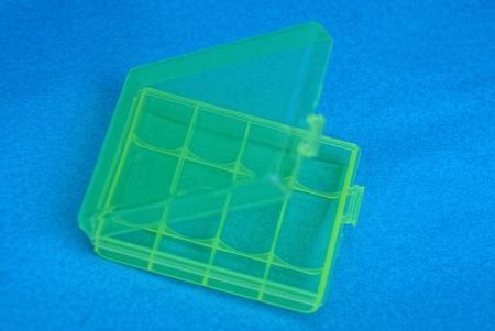 a small open green plastic box Stock Photo