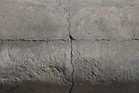 gray stone texture from an old cracked concrete wall
