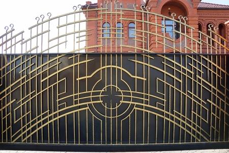 yellow metal gate on a city street