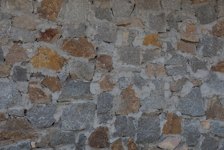 brown gray cobble stone background in concrete foundation wall Stock Photo