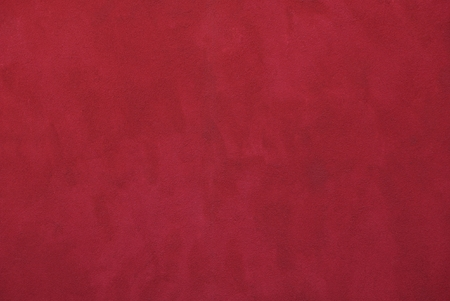 red paint texture on concrete wall plaster Stock Photo
