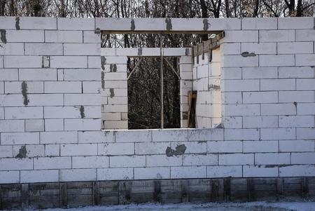 empty window gray unfinished house Stock Photo