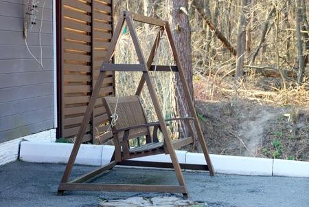 green wooden swing