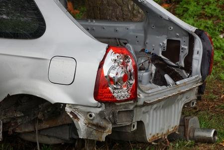 red glass broken rear light on a gray car