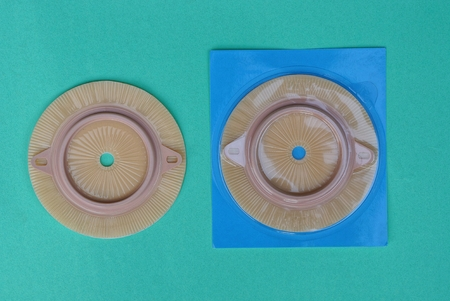 two brown round plastic calorie lying on a green table