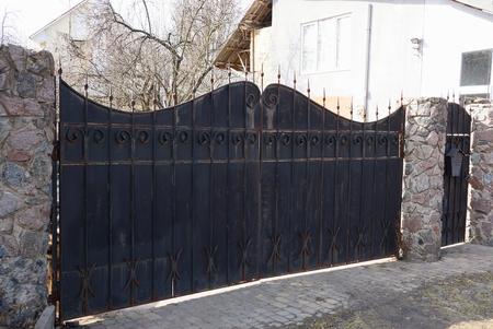 black and dirty metal gate