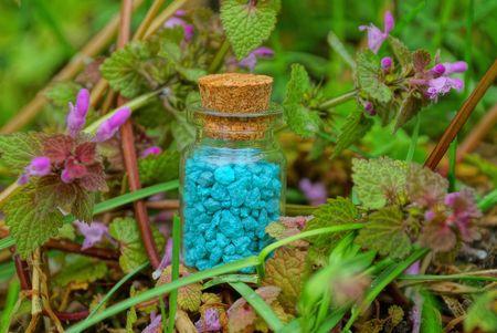 small blue sand glass bottle Banco de Imagens