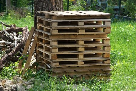 a row of brown wooden pallets 写真素材