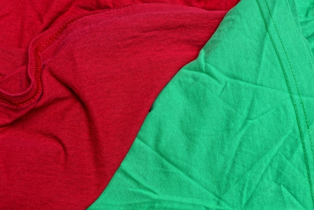 red green fabric texture from a piece of crumpled matter on clothes Stock Photo