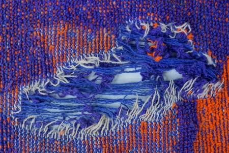 torn piece of woolen clothes