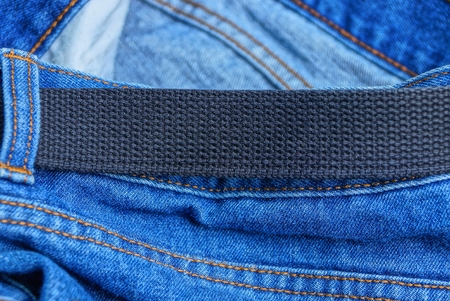 black long belt with blue coton jeans 写真素材