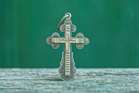 silver cross on white background