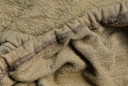 gray green fabric texture crumpled cloth with seam