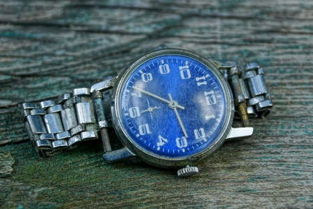 one blue old shabby watch with a metal strap Stock Photo