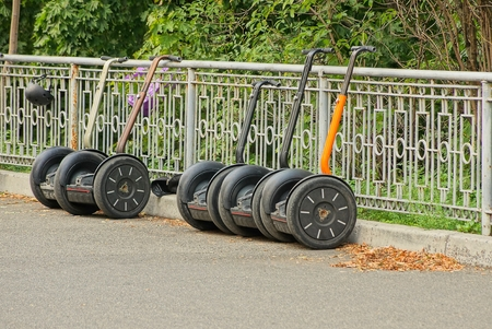 a row of electric scooters on the road