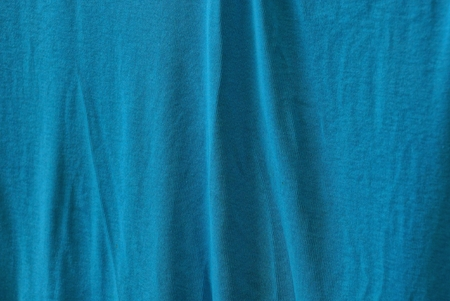 blue fabric texture from a piece of crumpled cloth on clothes Archivio Fotografico - 124985822